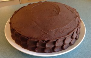 chocolate cake with caramel ganache and praline filling
